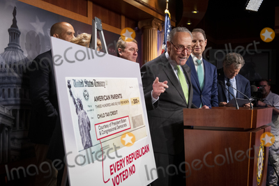 Photos From United States Senate Majority Leader Chuck Schumer (Democrat of New York) holds a press conference on Child Tax Credit Payments