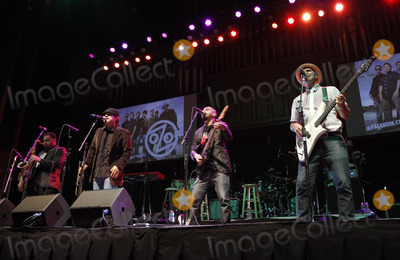 Asdrubal Sierra Photo - March 14 2013 - Atlanta GA - Grammy winners Ozomatli performed as part of Gabriel Iglesias Stand Up Revolution Tour when it made a stop at The Tabernacle in Atlanta GA Six comics and Ozomatli performed for two sold-out nights in the southern capital Photo credit Dan HarrAdMedia