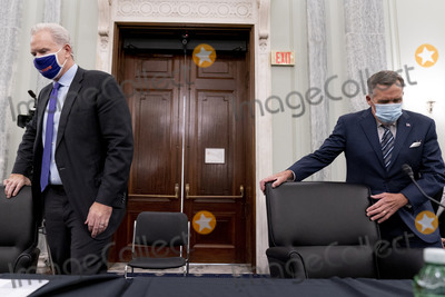 Richard Smith Photo - FedEx Express Regional President of the Americas and Executive Vice President Richard Smith left and United Parcel Service President of Global Healthcare Wesley Wheeler right arrive to testify at a Senate Transportation subcommittee hybrid hearing on transporting a coronavirus vaccine on Capitol Hill Thursday Dec 10 2020 in Washington Credit Andrew Harnik  Pool via CNPAdMedia