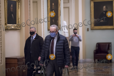 Photos From United States Senate Minority Leader Chuck Schumer (Democrat of New York) arrives at the U.S. Capitol as the Senate convenes.