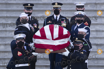 Photo - The casket of US Capitol Police Officer William Evans is carried by a joint service honor guard down the East Front steps of the US Capitol after lying in honor in the Capitol Rotunda in Washington DC USA 13 April 2021 A Tribute and Lying in Honor Ceremony took place for Officer Evans who was killed and another officer injured in the line of duty when a suspect rammed a vehicle at the North entrance of the Capitol 02 AprilCredit Michael Reynolds  Pool via CNPAdMedia