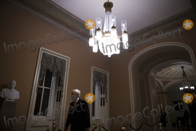 Photos From United States Senate Majority Leader Mitch McConnell (Republican of Kentucky) leaves the Senate chamber at the US Capitol during a vote.