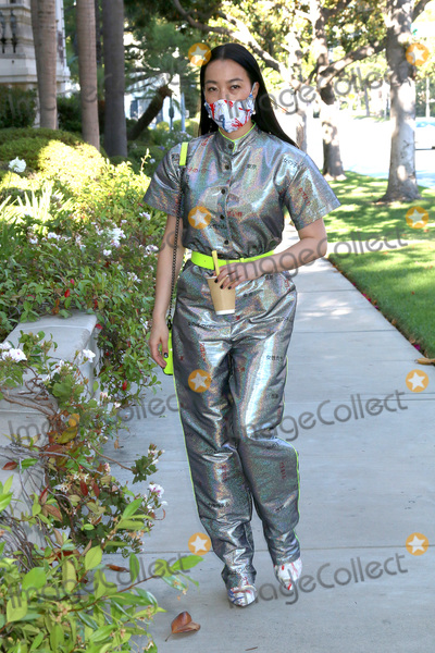 Photos From Yi Zhou out and about in outfit, mask, shoes, and accessories by