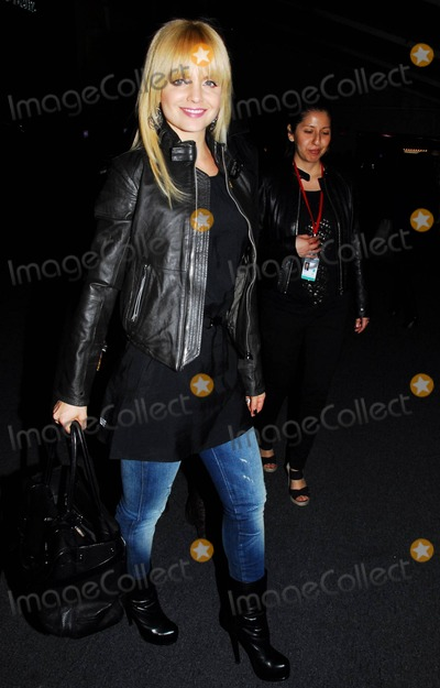 At Last Photo - With much longer hair than at last years fashion week actress Mena Suvari at Mercedes-Benz Fashion Week events on day three of the influential occasion that runs from February 10th to the 17th New York NY 021211