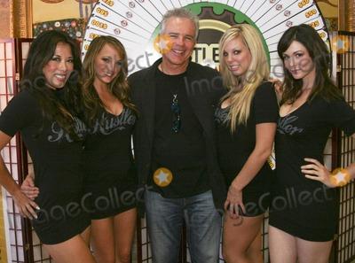 Anthony JOHN Denison Photo - Anthony John Denison poses on the red carpet during Larry Flynts Hustler Casino Celebrity  Fan Poker Tournament Los Angeles CA 092610