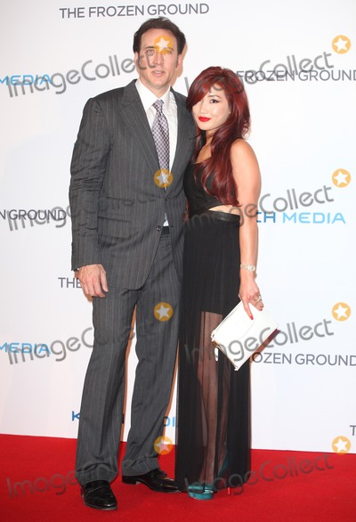 Alice Kim Photo - Nicolas Cage and wife Alice Kim arriving at The Frozen Ground UK Premiere at Vue West End London 17072013 Picture by Alexandra Glen  Featureflash