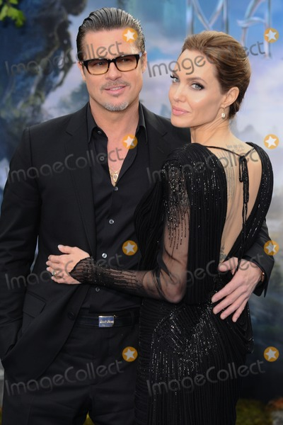 Photo - Brad Pitt and Angelina Jolie arrives for the Maleficent costume display opening at Kensington Palace London 08052014 Picture by Steve Vas  Featureflash