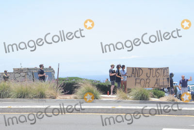 Photo -  Protesters in front of the Trump National Golf Club