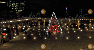 Photo - London UK Terrarium Tree Kings Cross Londons newest creative neighbourhood launched its traditionally untraditiona Christmas Kings Cross has become known for its unconventional take on Christmas and 2020 is just as extraordinarySet throughout the Kings Cross neighbourhood are three iconic Christmas trees each delivering an alternative unexpected interpretation of the traditional festive tree Granary Square plays host to the Electric Nemeton Tree designed by local architecture practice Sam Jacob StudioIn Coal Drops Yard sits the Terrarium Tree a sustainable creation comprised of 70 living Botanical Boys terrariums and in Battle Bridge Place is the Peoples Tree an interactive multi-coloured installation illuminated by the steps and sensory movements of visitors Kings Cross London November 25th 2020Ref LMK73-J6700-261120Keith MayhewLandmark MediaWWWLMKMEDIACOM