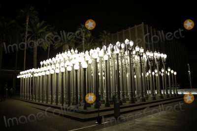 Photo - MIRACLE MILE LOS ANGELES CALIFORNIA USA - MARCH 28 An exterior view of the Urban Light street lamps installation outside the Los Angeles County Museum of Art (LACMA) at 5905 Wilshire Blvd on March 28 2020 in Miracle Mile Los Angeles California United States Urban Light is a large-scale assemblage sculpture by Chris Burden located at the Wilshire Boulevard entrance to the Los Angeles County Museum of Art The 2008 installation consists of restored street lamps from the 1920s and 1930s Most of them once lit the streets of Southern California Los Angeles County Museum of Art (LACMA) is temporarily closed after the Safer at Home order issued by both Los Angeles Mayor Eric Garcetti at the county level and California Governor Gavin Newsom at the state level on Thursday March 19 2020 which will stay in effect until at least April 19 2020 (Photo by Xavier CollinImage Press Agency)
