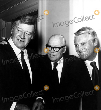 Henry Hathaway Photo - John Wayne Motion Picture Director Henry Hathaway and Cary Grant at the Beverly Hills Hotel Party Honoring Mr Hathaway on His 75th Birthday 1973 A1595 Nate CutlerGlobe Photos Inc Johnwayneobit