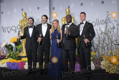 ANTHONY KATAGAS Photo - Anthony Katagas Jeremy Kleiner Dede Gardner Brad Pitt and Steve Mcqueen Pose in the Press Room During the Oscars at Loews Hollywood Hotel on March 2nd 2014 Hollywood Californiausa PhototloweGlobephotos