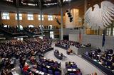 Angela Merkel Photo - Bundeskanzlerin Angela Merkel (CDU) gab am 29 Januar 2014 ihre Regierungserklaerung im Deutschen Bundestag im Sitzen ab German Chancellor Angela Merkel (CDU) announced on 29 January 2014 her government declaration by sitting in the German Bundestag The picture shows the plenary of the German Bundestag and Angela Merkel (CDU) sitting at the lecternCredit Stockiface to face
