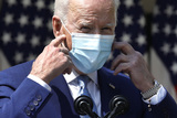 White House Photo - US President Joe Biden removes a protective face mask to deliver remarks on gun violence prevention in the Rose Garden of the White House in Washington on April 8 2021 Credit Yuri Gripas  Pool via CNPAdMedia