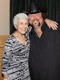 Nancy Denson Photo - August 16 2011 - Athens GA - Athens GA Mayor Nancy Denson with Colt Ford Country artist Colt Ford rounded up his songwriter and artist friends to hold a benefit for the family of Elmer Buddy Christian an Athens Police Officer who died in the line of duty  Prior to the show Colt and friends met fans at a VIP party  Photo credit Dan HarrAdMedia