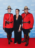 Alanis Morissette Photo - 15 March 2015 - Hamilton Ontario Canada  Alanis Morissette poses on the red carpet during the 2015 JUNO Awards at FirstOntario Centre Photo Credit Brent PerniacAdMedia