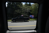 American Flag Photo - A vehicle displays an American flag and a flag showing support for United States President Donald J Trump as it drives past Trump National Golf Club in Sterling Virginia US on Sunday August 23 2020  Trump is expected to kick off the Republican National Convention with a speech in Charlotte North Carolina on Monday and officially accept the Republican nomination from the White House lawn on Thursday  Credit Stefani Reynolds  Pool via CNPAdMedia