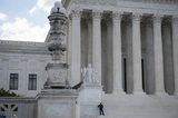 Supremes Photo - A police officer stands on the steps of the Supreme Court of the United States which began began hearing arguments considering whether or not President Trump can shield his income tax returns from disclosure keeping his private financial records from congressional committees and a New York prosecutor in Washington DC Tuesday May 12 2020 Credit Rod Lamkey  CNPAdMedia