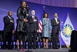President Obama Photo - United States President Barack Obama and First Lady Michelle Obama listen to the National Anthem sung by Denyce Graves at the groundbreaking ceremony of the Smithsonian National Museum of African American History and Culture in Washington DC on Wednesday February 22 2012 The museum is scheduled to open in 2015 and will be the only national museum devoted exclusively to the documentation of African American life art history and culture From left to right US Representative John Lewis (Democrat of Georgia) Denyce Graves Wayne Clough Secretary Smithsonian Institution Mrs Obama and President ObamaCredit Andrew Harrer  Pool via CNPAdMedia