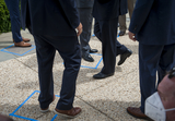 House Speaker Nancy Pelosi Photo - Republican members of Congress arrive and stand outside of the safe distancing squares identified on the pavement prior to House Minority Leader Rep Kevin McCarthys (R-Calif) press conference with House Minority Whip Rep Steve Scalise (R-LA) House GOP Conference Chairwoman Liz Cheney (R-WY) and others to announce that Republican leaders have filed a lawsuit against House Speaker Nancy Pelosi and congressional officials in an effort to block the House of Representatives from using a proxy voting system to allow for remote voting during the coronavirus pandemic outside of the US Capitol in Washington DC Wednesday May 27 2020 Credit Rod Lamkey  CNPAdMedia