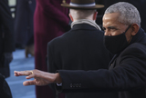 Barack Obama Photo - Former US President Barack Obama gestures as he attends the inauguration of Joe Biden as the 46th President of the United States on the West Front of the US Capitol in Washington US January 20 2021 REUTERSJonathan ErnstAdMedia