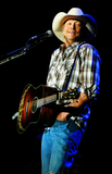 Alan Jackson Photo - 21 April 2012 - Hamilton Ontario Canada  Country music star Alan Jackson performs on stage at Copps Coliseum Photo Credit Brent PerniacAdMedia