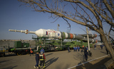 Train Photo - The Soyuz rocket is rolled out by train to the launch pad at Site 31 Tuesday April 6 2021 at the Baikonur Cosmodrome in Kazakhstan Expedition 65 NASA astronaut Mark Vande Hei Roscosmos cosmonauts Pyotr Dubrov and Oleg Novitskiy are scheduled to launch aboard their Soyuz MS-18 spacecraft on April 9  Mandatory Credit Bill Ingalls  NASA via CNPAdMedia