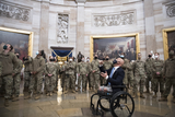 The National Photo - United States Representative Brian Mast (Republican of Florida) introduces members of the National Guard to the Rotunda at the US capitol as the House of Representatives vote on H Res 24 Impeaching Donald John Trump President of the United States for high crimes and misdemeanors at the US Capitol in Washington DC Wednesday January 13 2021 Credit Rod Lamkey  CNPAdMedia