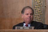 Doug Jones Photo - United States Senator Doug Jones (Democrat of Alabama) listens as Chair of the Federal Reserve Jerome Powell testifies before the US Senate Committee on Banking Housing and Urban Affairs at the United States Capitol in Washington DC US on Wednesday February 12 2020  Credit Stefani Reynolds  CNPAdMedia