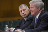 The National Photo - Bob Bowlsby Commissioner of the Big 12 Conference listens as Mark Emmert President of the National Collegiate Athletic Association testifies alongside Dr Douglas Girod Chancellor of the University of Kansas Ramogi Huma Executive Director of the National College Players Association and Kendall Spencer Chair of the Student-Athlete Advisory Committee before the Subcommittee on Manufacturing Trade and Consumer Protection at the United States Capitol in Washington DC US on Tuesday February 11 2020  Credit Stefani Reynolds  CNPAdMedia