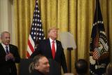 Benjamin Netanyahu Photo - United States President Donald J Trump speaks as Israels Prime Minister Benjamin Netanyahu looks on during a meeting in the East Room of the White House in Washington DCon Tuesday January 28 2020 Credit Joshua Lott  CNPAdMedia
