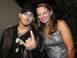 Brantley Gilbert Photo - August 16 2011 - Athens GA - Brantley Gilbert and Melissa Christian wife of slain officer Country artist Colt Ford rounded up his songwriter and artist friends to hold a benefit for the family of Elmer Buddy Christian an Athens Police Officer who died in the line of duty  On hand were Jason Aldean Edwin McCain Rhett Akins Dallas Davidson James Otto Rachel Farley Corey Smith Brantley Gilbert and Mike Dekel The performance was held for a packed house at the reconstructed and recently reopened Georgia Theater Photo credit Dan HarrAdMedia