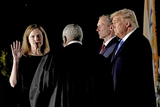Supremes Photo - Associate Justice of the Supreme Court Clarence Thomas administers the oath of office to Judge Amy Coney Barrett to be Associate Justice of the Supreme Court on the South Lawn of the White House in Washington DC on Monday October 26 2020  US President Donald J Trump and her husband Jesse M Barrett look onCredit Ken CedenoPool via CNPAdMedia