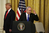 Benjamin Netanyahu Photo - Israels Prime Minister Benjamin Netanyahu salutes as United States President Donald J Trump looks on during a meeting in the East Room of the White House in Washington DCon Tuesday January 28 2020 Credit Joshua Lott  CNPAdMedia