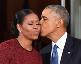 Barack Obama Photo - President Barack Obama (R) gives Michelle Obama a kiss as they wait for President-elect Donald Trump and wife Melania at the White House before the inauguration on January 20 2017 in Washington DC  Trump becomes the 45th President of the United States Photo Credit Kevin DietschCNPAdMedia