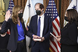 The Unit Photo - United States Vice President Kamala Harris right swears in Samantha Power administrator of the United States Agency for International Development (USAID) alongside her husband Cass Sunstein holding the bible in the Eisenhower Executive Office Building in Washington DC US on Monday May 3 2021 The Senate confirmed Power who was an ambassador to the United Nations during the Obama administration on April 28 Credit Oliver Contreras  Pool via CNPAdMedia