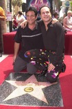 KC and the Sunshine Band Photo - Karry Wayne KC Casey and Fermin Goytisolo at KC and The Sunshine Band induction ceremony into Hollywoods Walk of Fame Hollywood Blvd CA 08-02-02