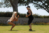 The Fames Photo - Frenchy Morgan Suzie Malonethe Celebrity Big Brother Star and the Famed Burlesque Performer are spotted working out together on the lawn of Pepperdine Universitry in Malibu CA 08-11-17