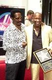 Ike Turner Photo - Ike Turner and John Singleton at Singletons induction into the Hollywood Walk of Fame Hollywood CA 08-26-03