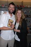 John Holmes Photo - James Cox and Dawn Schillerat a signing for Dawn Schillers The Road Through Wonderland Surviving John Holmes Bookstar Studio City CA 08-28-10