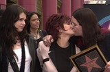 Aimee Osbourne Photo - Aimee Osbourne looks on as Mom Sharon and Dad Ozzy kiss at Ozzys star on the Walk of Fame ceremony in front of Ripleys Believe It Or Not museum on Hollywood Blvd 04-12-02