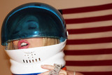 American Flag Photo - Nadeea Volianovathe Russian Pop Stars bizarre naked New Years Art Installation featuring an American flag the named Putin and Trump in huge letters and the singer wearing a space helmet and not much else Art Threat Gallery Las Vegas NV 12-29-16