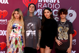 Travis Barker Photo - LOS ANGELES - MAR 14  Alabama Barker Travis Barker Atiana De La Hoya Landon Barke at the iHeart Radio Music Awards - Arrivals at the Microsoft Theater on March 14 2019 in Los Angeles CA