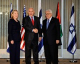 Mahmoud Abbas Photo - Prime Minister Benjamin Netanyahu of Israel (center) shakes hands with President Mahmoud Abbas of the Palestinian Authority (right) as United States Secretary of State Hillary Rodham Clinton (left) looks on at the Prime Ministers Residence in Jerusalem Israel on Wednesday September 15 2010 Photo by Department of StateCNP-PHOTOlinknet
