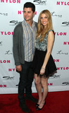 Ben Nemtin Photo - TV personality Whitney Port (R) with boyfriend Ben Nemtin pose for photographers on the red carpet at NYLON magazines 12th anniversary party held at Tru and hosted by the ravishing and beautiful stars of the new epic action fantasy movie Sucker Punch Los Angeles CA 032411