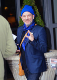 R E M Photo - Wearing a blue cap REM frontman Michael Stipe grins and waves to photographers as he leaves his hotel in London UK 31111