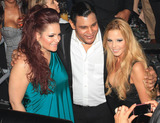 Ana Carolina da Fonseca Photo - Rapper Pitbull (aka Armando Christian Perez) celebrates his 30th birthday at Play nightclub with friends that included Mexican pop singer Cristian Castro former Major League Baseball player Sammy Sosa Brazilian-born actress Ana Carolina da Fonseca who surprised Pitbull when she walked out of a giant faux cake and Latin pop singer and actor Jencarlos Canela  Pitbull appeared to be in a great mood as he kissed and hugged Ana Carolina stuck out his tongue and posed with a comical sculpture of himself Pictured Sammy Sosa and wife Sonia Sosa Miami FL 011511