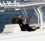 Anna Kournikova Photo - EXCLUSIVE Anna Kournikova and Enrique Iglesias bundle up against the cold for a romantic sunset boat trip Wearing sweaters and woolen hats the couple boarded Enriques triple engine fishing boat accompanied by their dog Miami Beach FL 121910Fees must be agreed prior to publication
