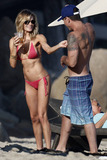 TI Photo - American country musician LeAnn Rimes seems joyful while she dazzles in a tiny coral bikini as she celebrates her 29th birthday in Malibu with husband Eddie Cibrian his sons family and friends Rimes and Cibrian tied the knot in April of this year after both divorcing their first spouses  The happy couple were quite affectionate enjoying the warm sun LeAnn was also seen playing with Eddies son Jake  Malibu CA 27th August 2011