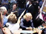 Gina Schock Photo - Belinda Carlisle and Gina Schock of the band The Go-Gos sign autographs at the Go-Gos Hollywood Walk of Fame Induction Ceremony in Hollywood CA  11th August 2011